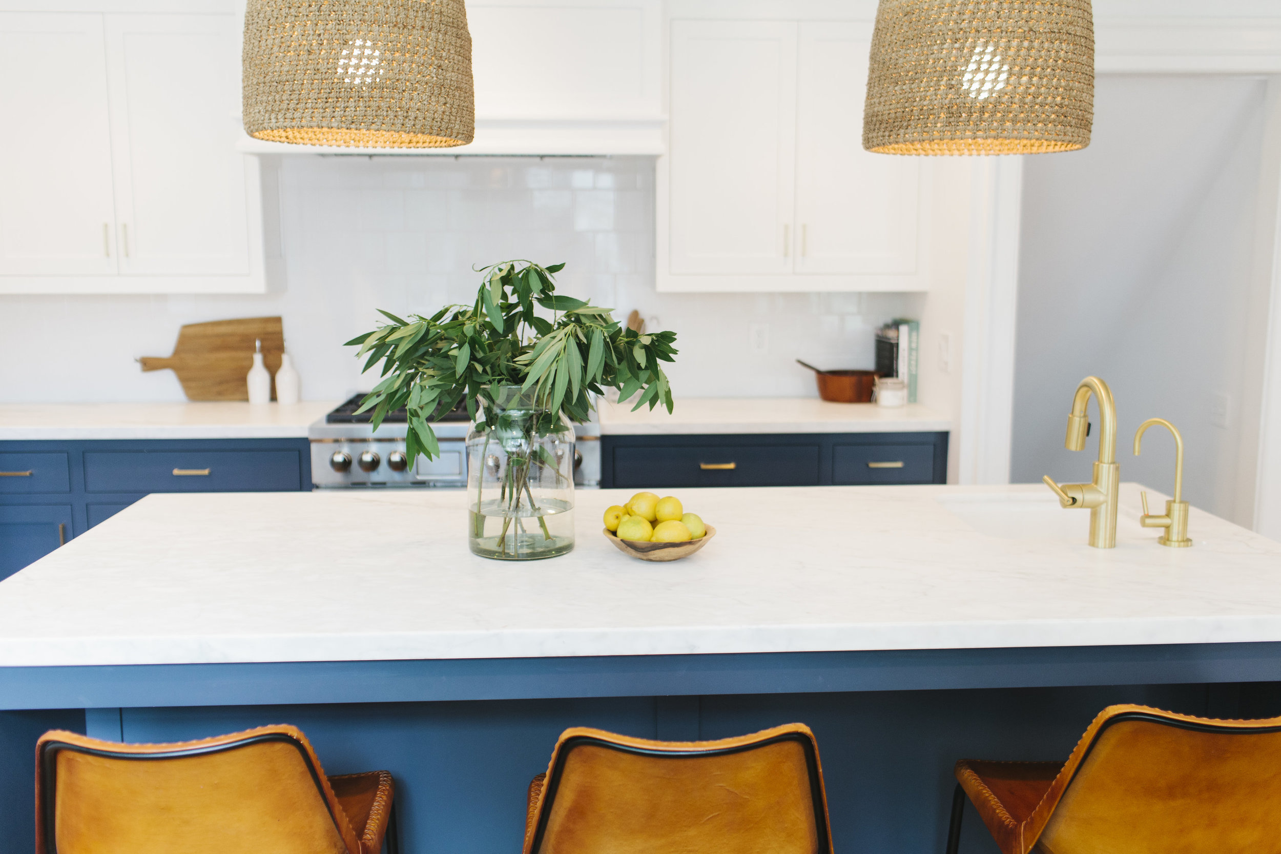 Navy, white & brass kitchen with leather stools || Studio McGee