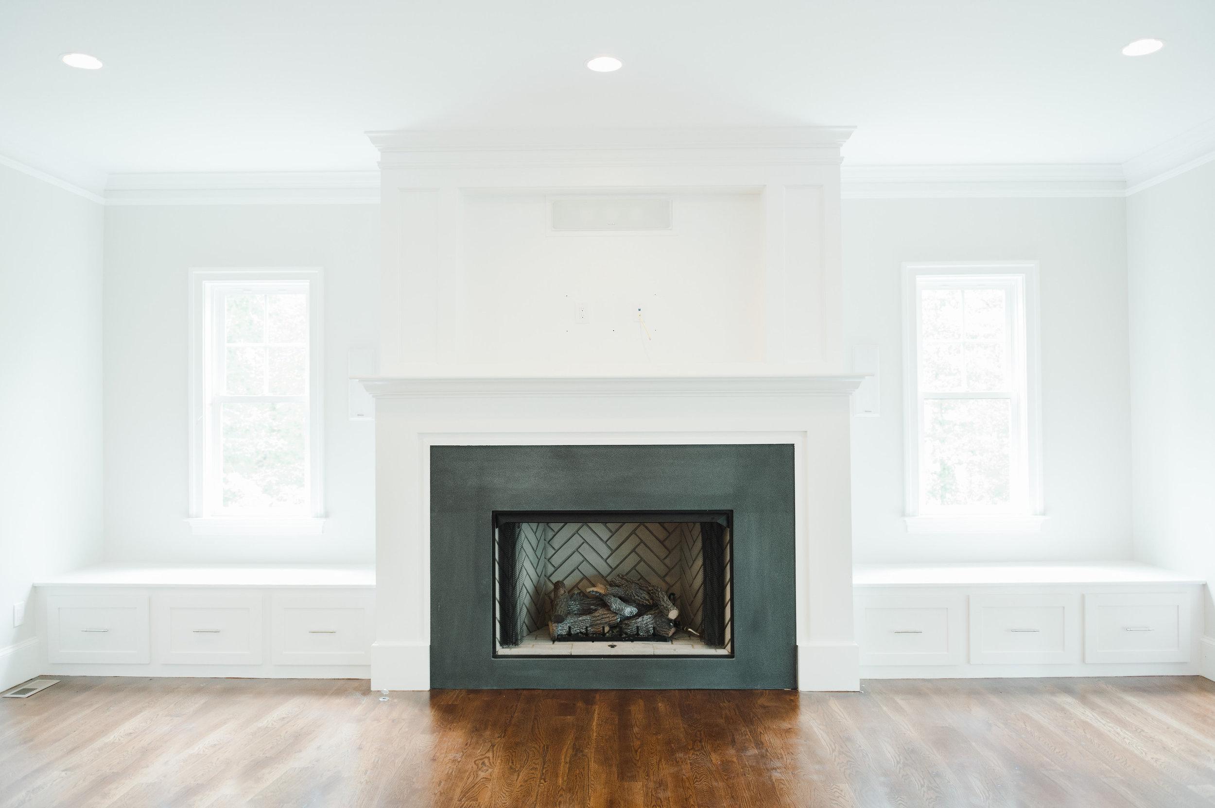 Fireplace design with black honed granite and herringbone firebox || Studio McGee