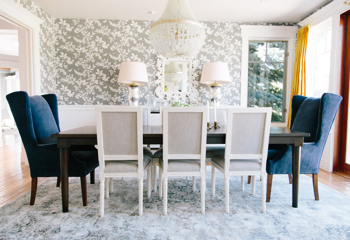 Stunning Formal Dining Room with gray wallpaper, yellow drapes and navy velvet wingbacks || Studio McGee