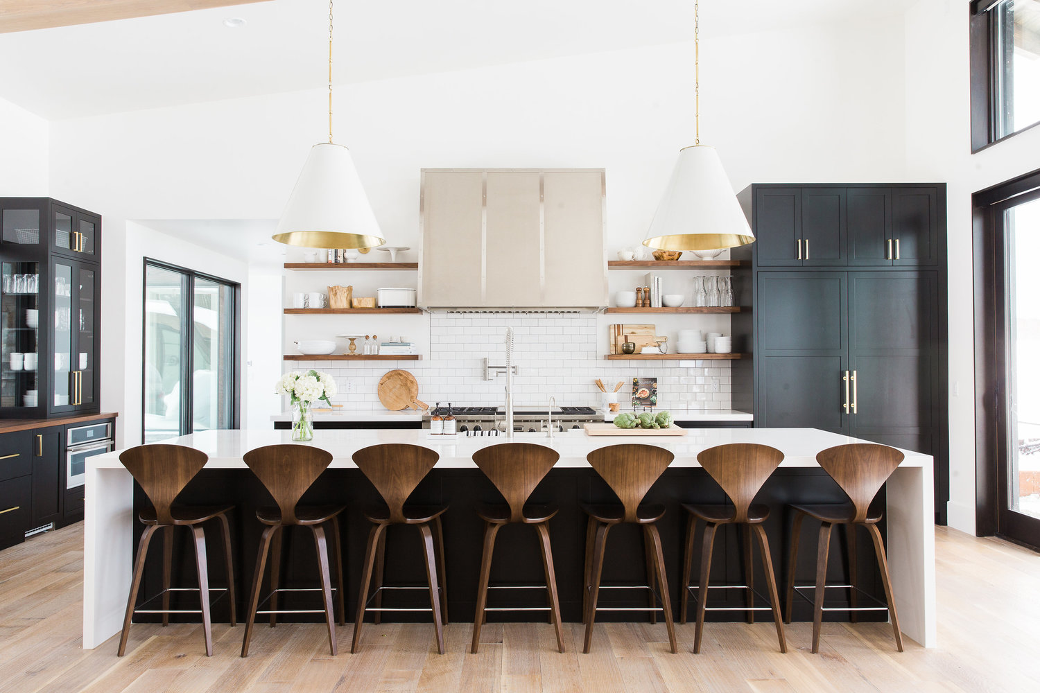 seven bar stools in front of kitchen island