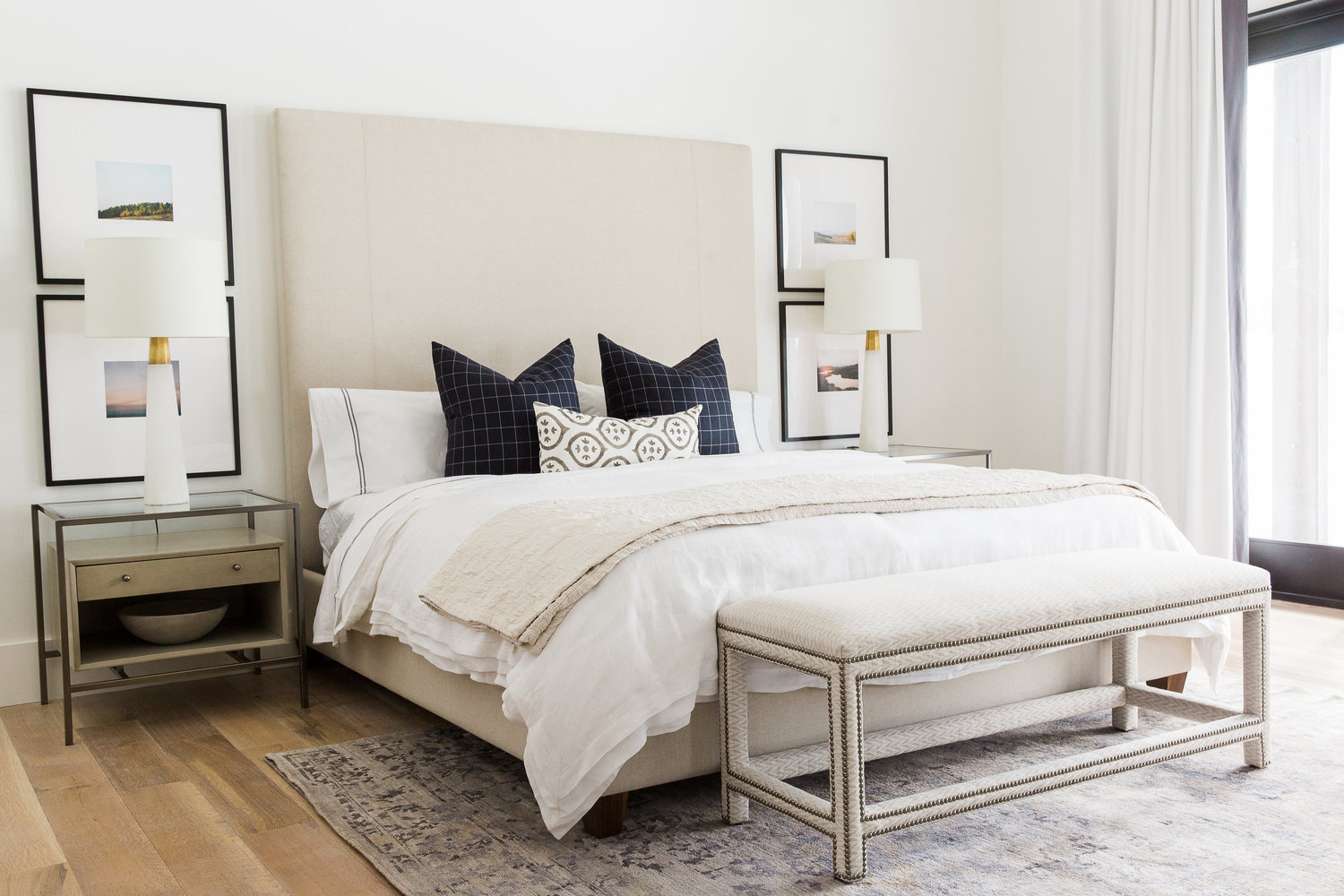 White king bed with tall tan headboard