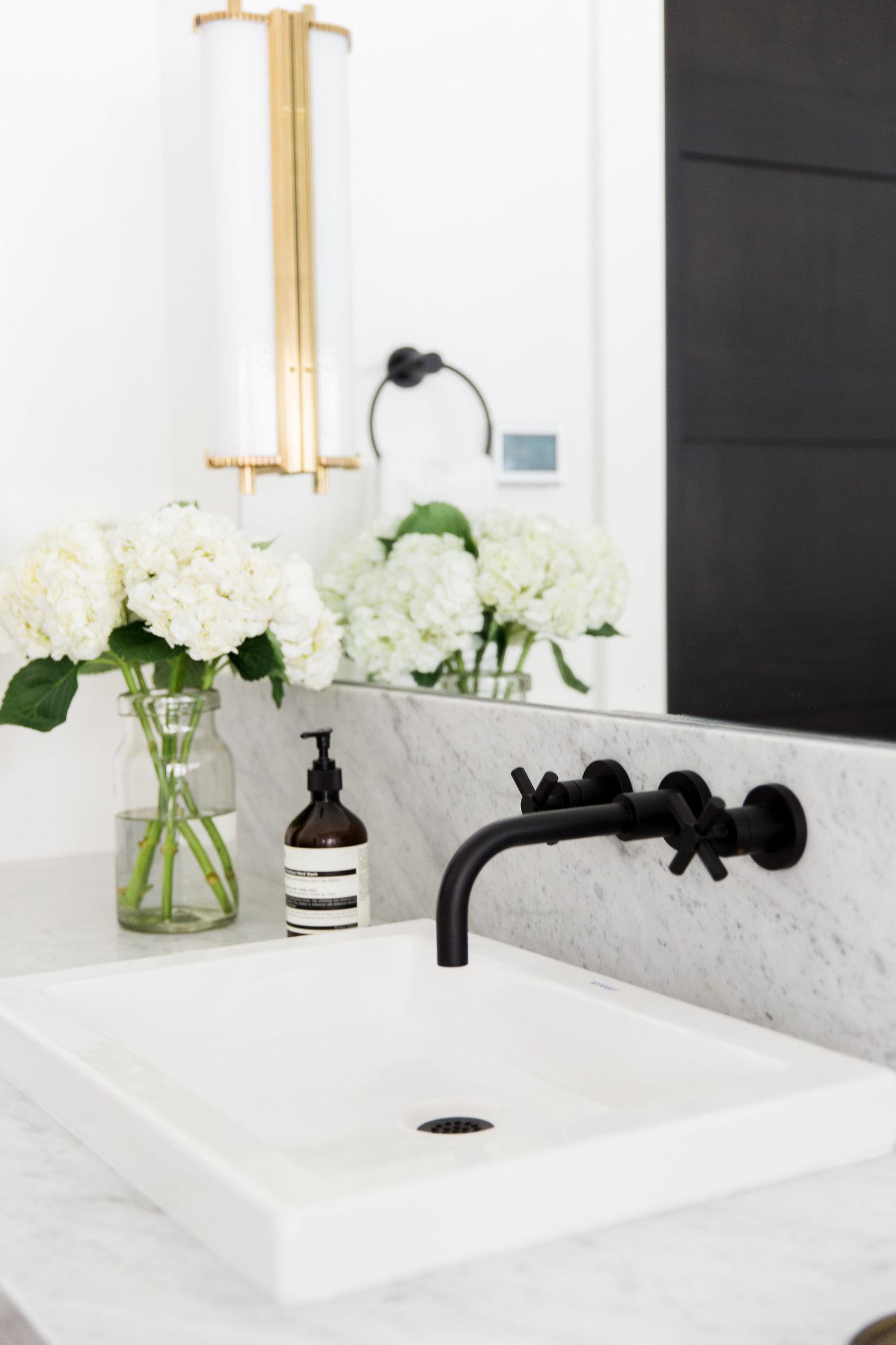 Brushed black faucet above vanity sink