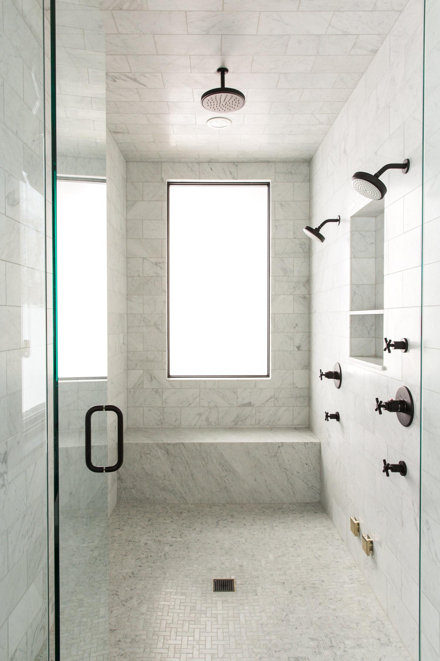 Open glass door to large standing shower