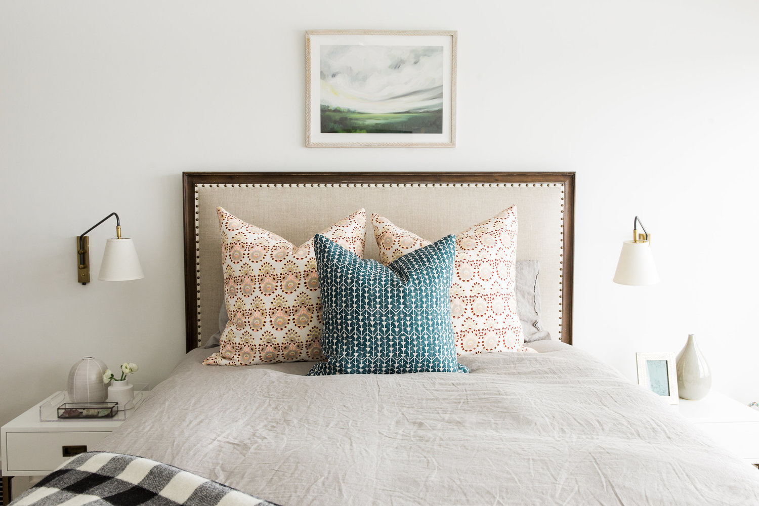 Decorative pillows sitting on twin bed