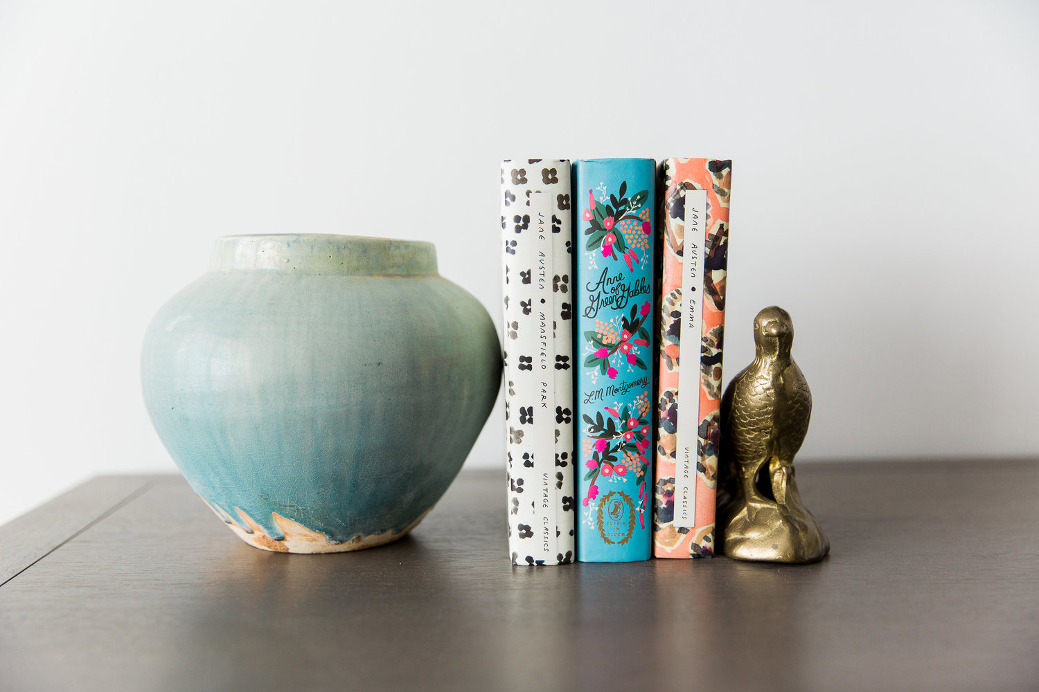 Books and vase on top of counter