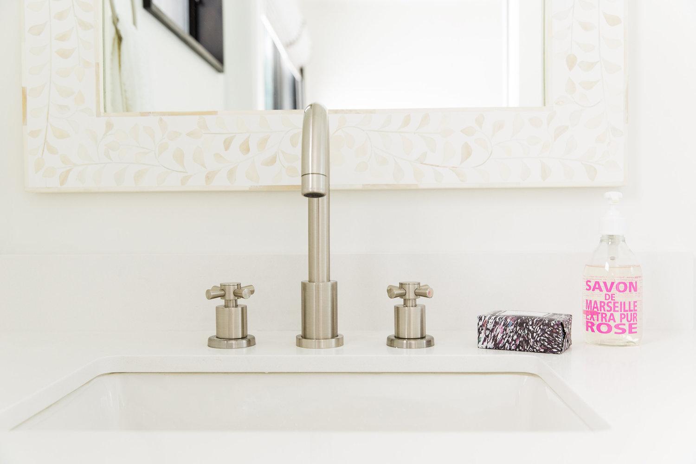 Brushed nickel details on bathroom sink