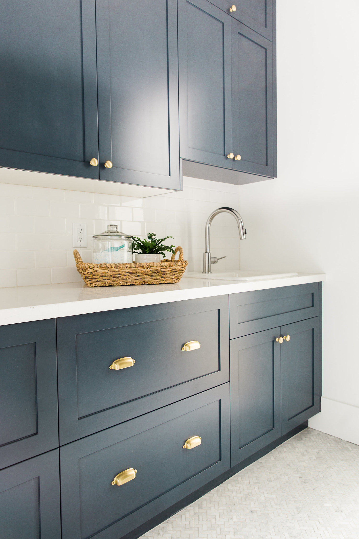 Dark blue cabinets with white counter tops