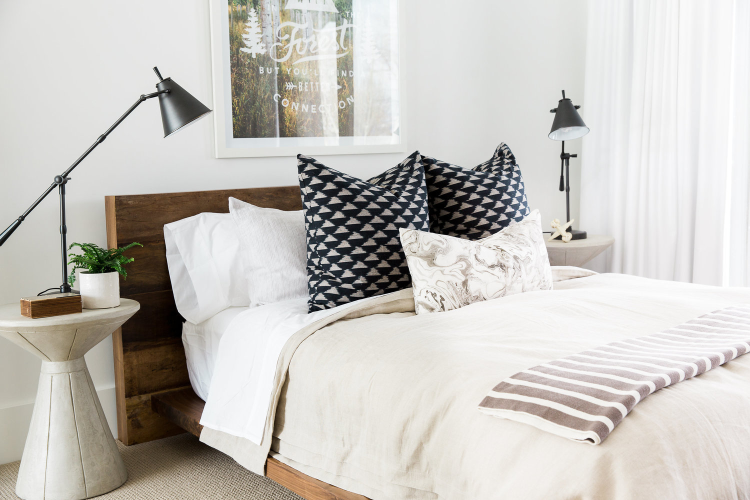 White bed with wooden headboard