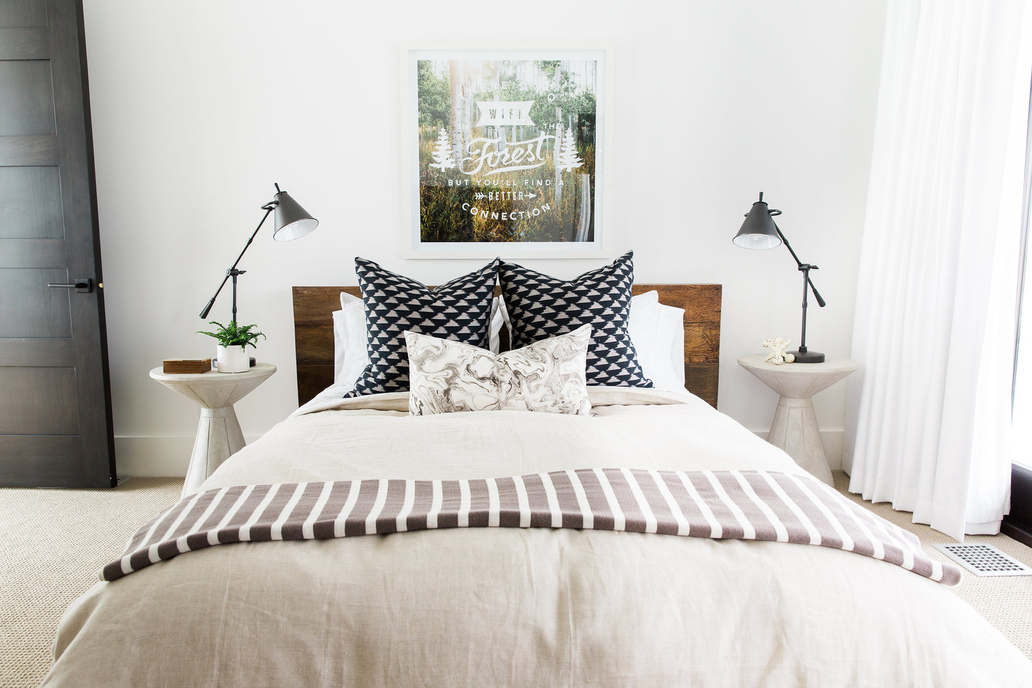 White bed with navy pillow accents