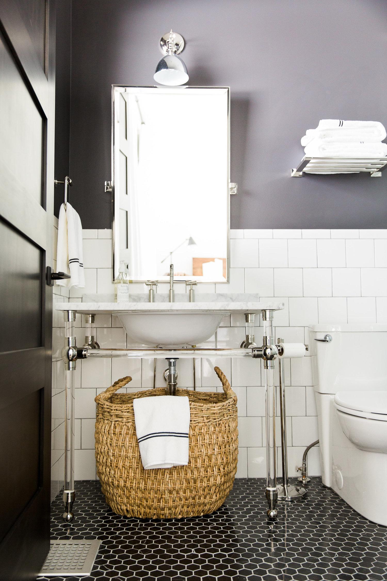 Wicker basket beneath bathroom vanity