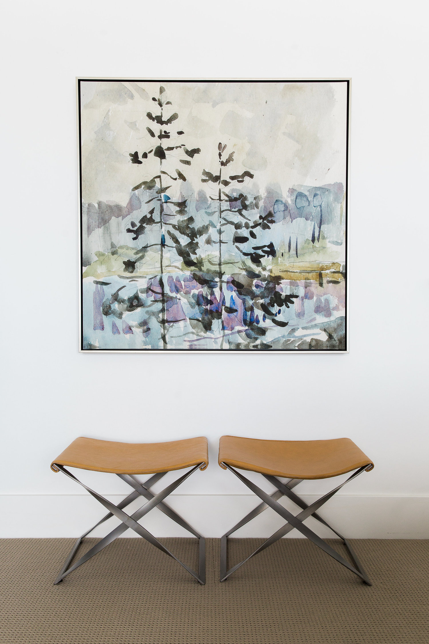 Collapsible stools underneath wall art