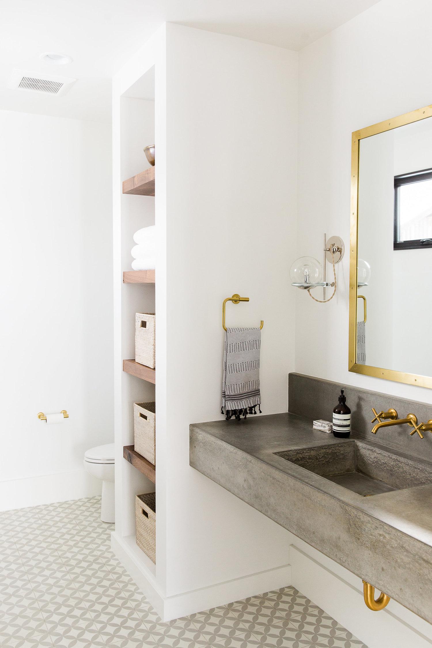 Built in linen shelves next to bathroom vanity