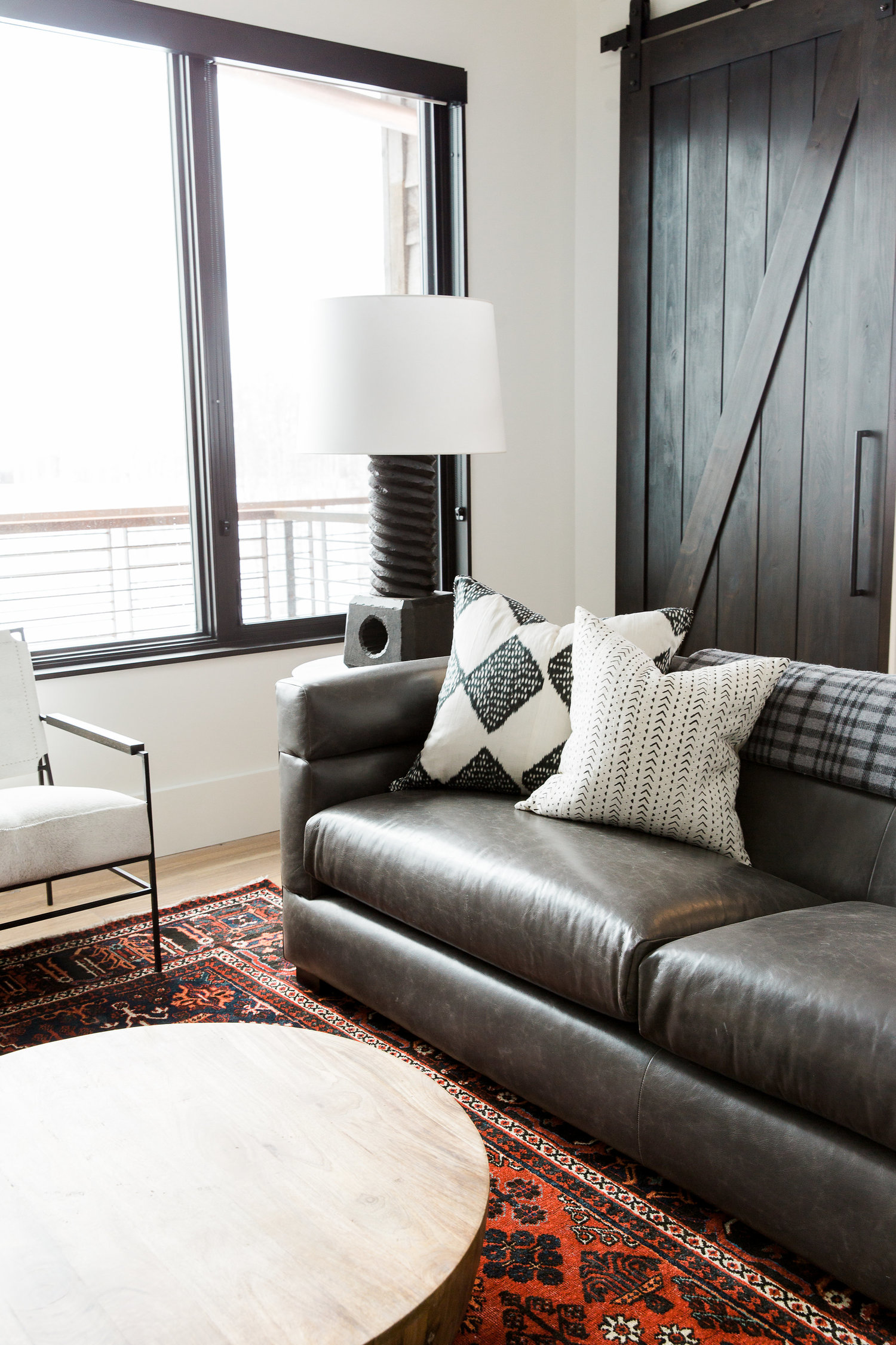 Brown couch with round coffee table in front