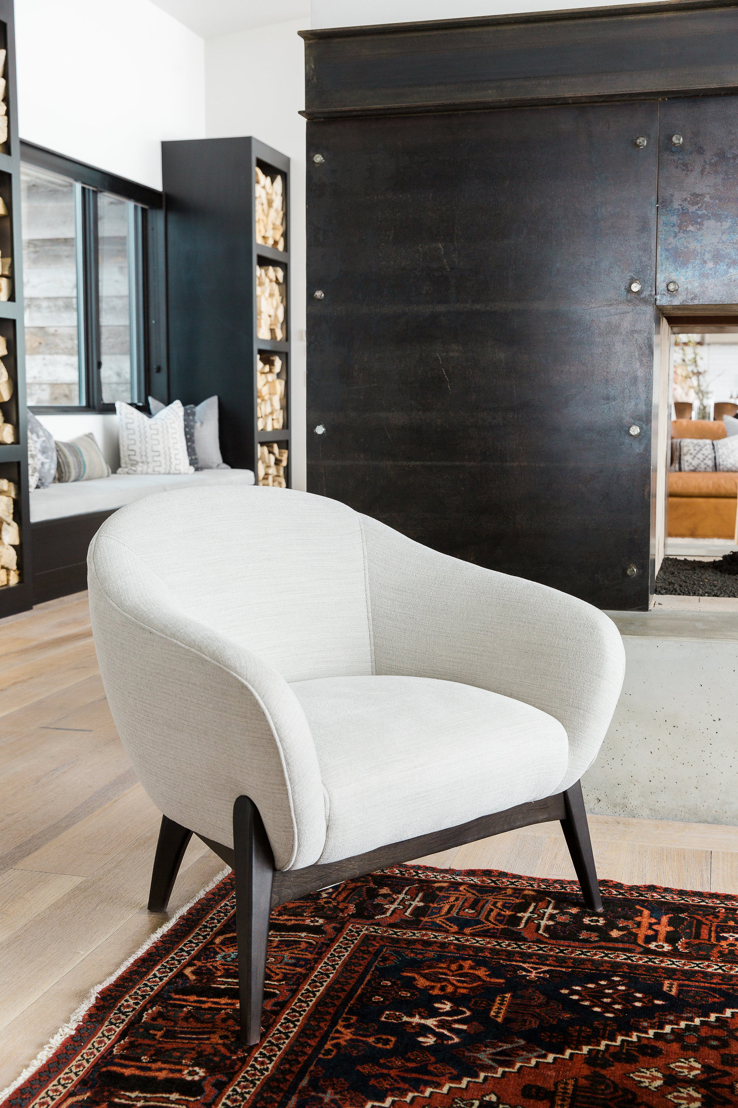 White seat on top of decorative rug