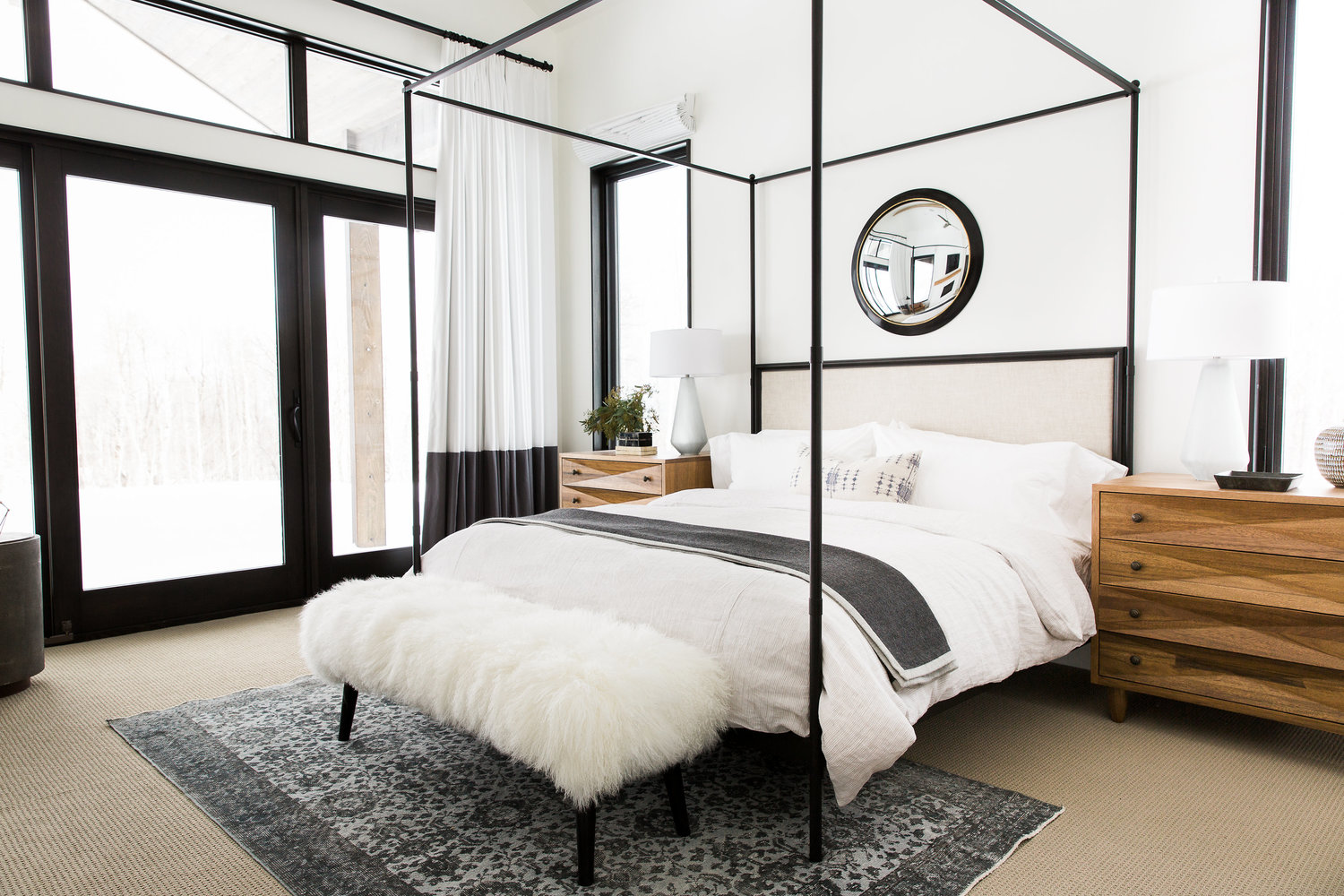 White bed with metal frame in bedroom