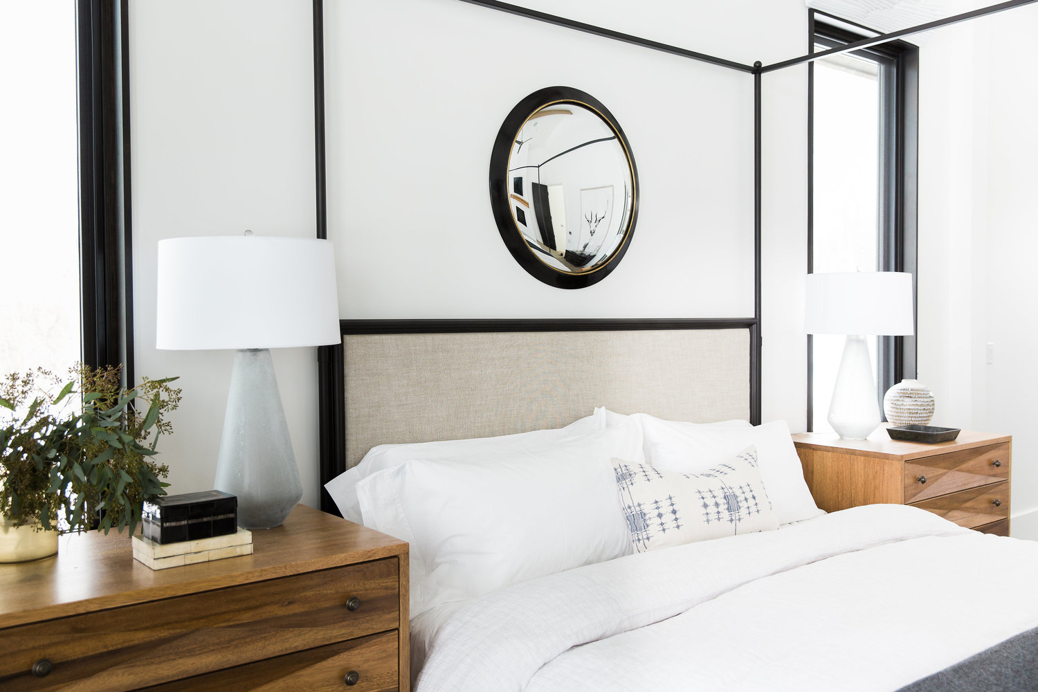 Two wooden nightstands on either side of the bed