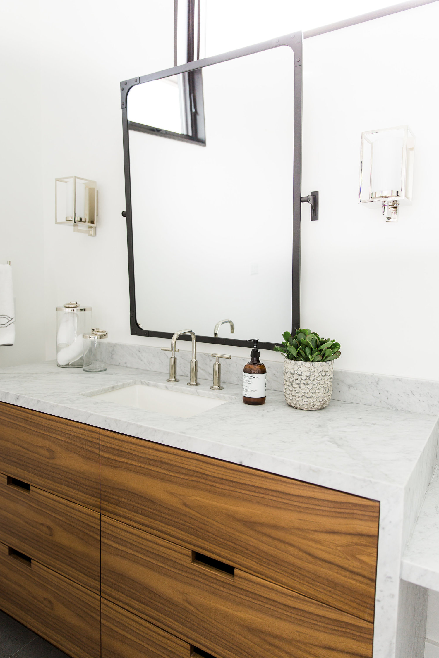 White bathroom vanity with wooden drawers