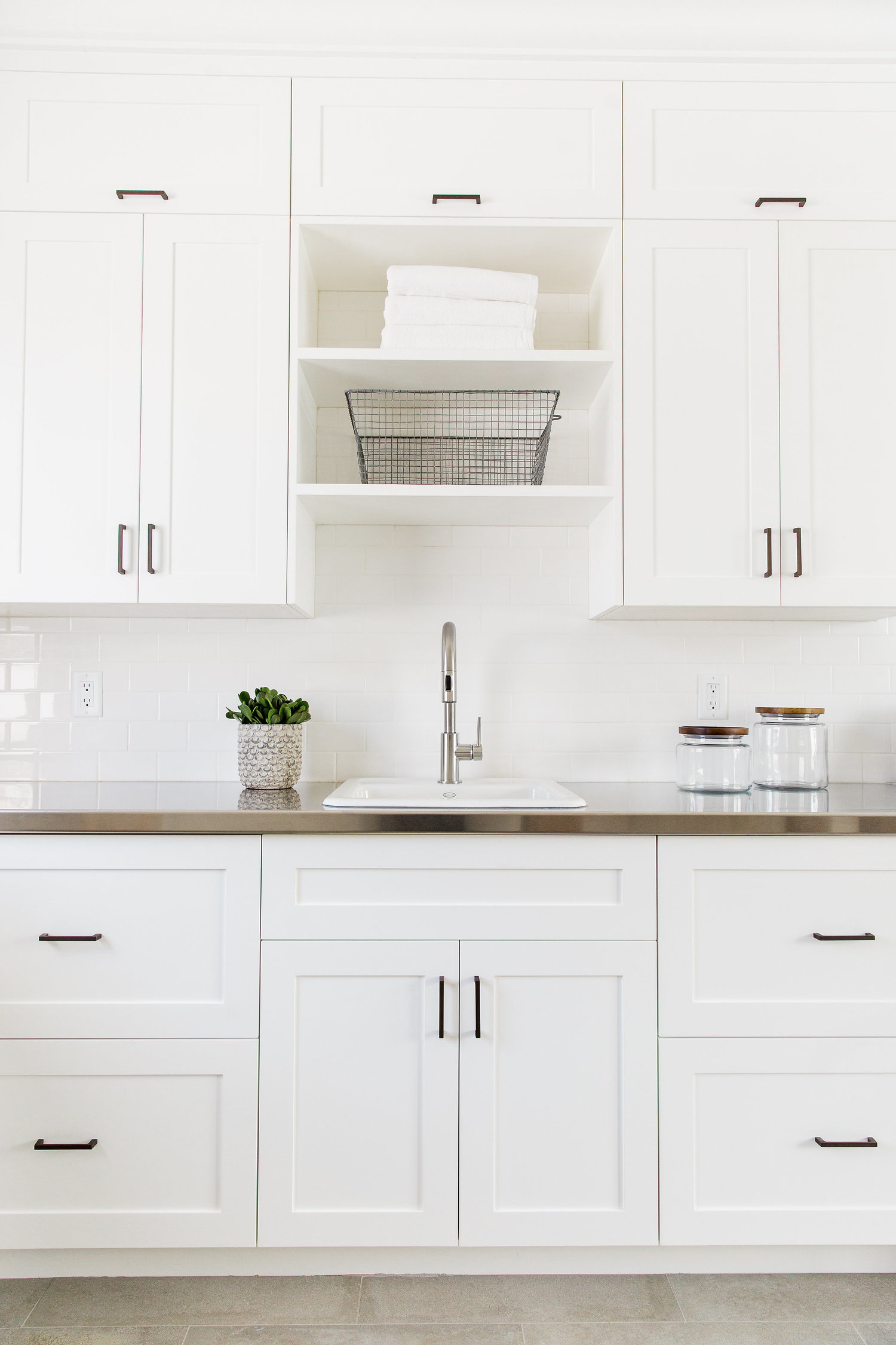 White kitchen cabinets with large sink
