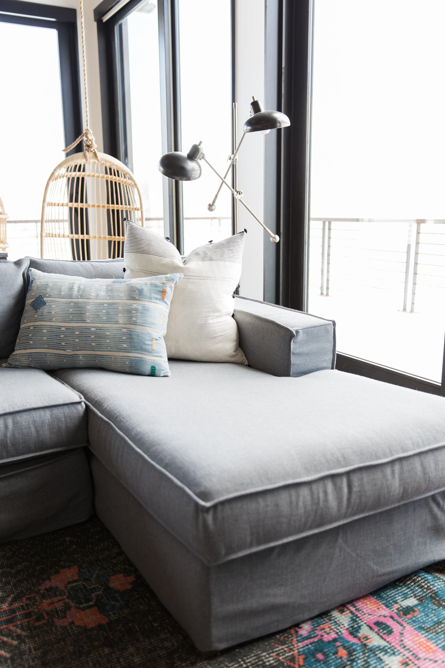 Footrest of grey sectional couch