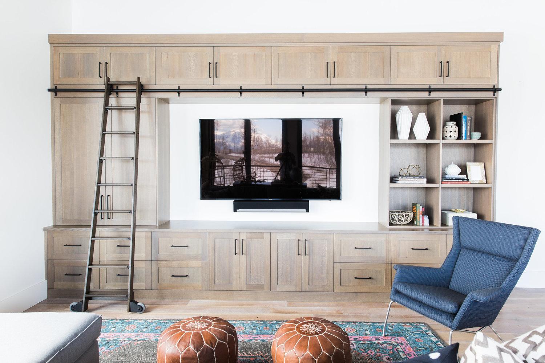 Wooden shelving unit around flat screen TV