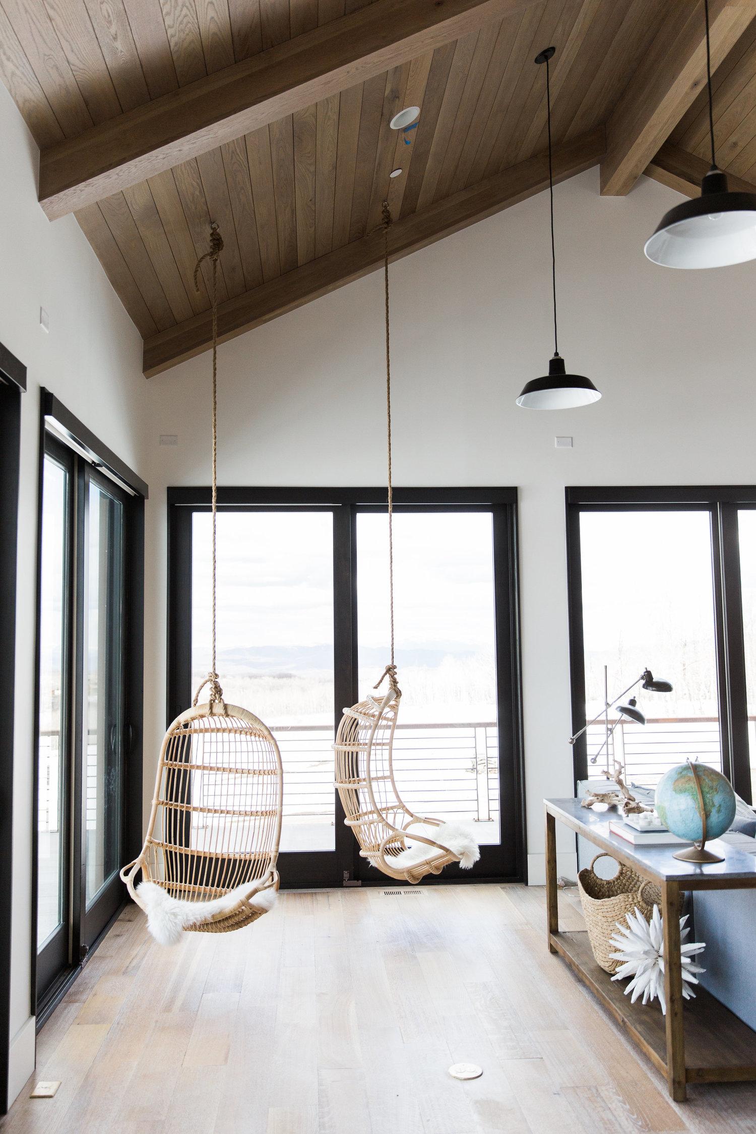 hanging white chairs in house bonus room