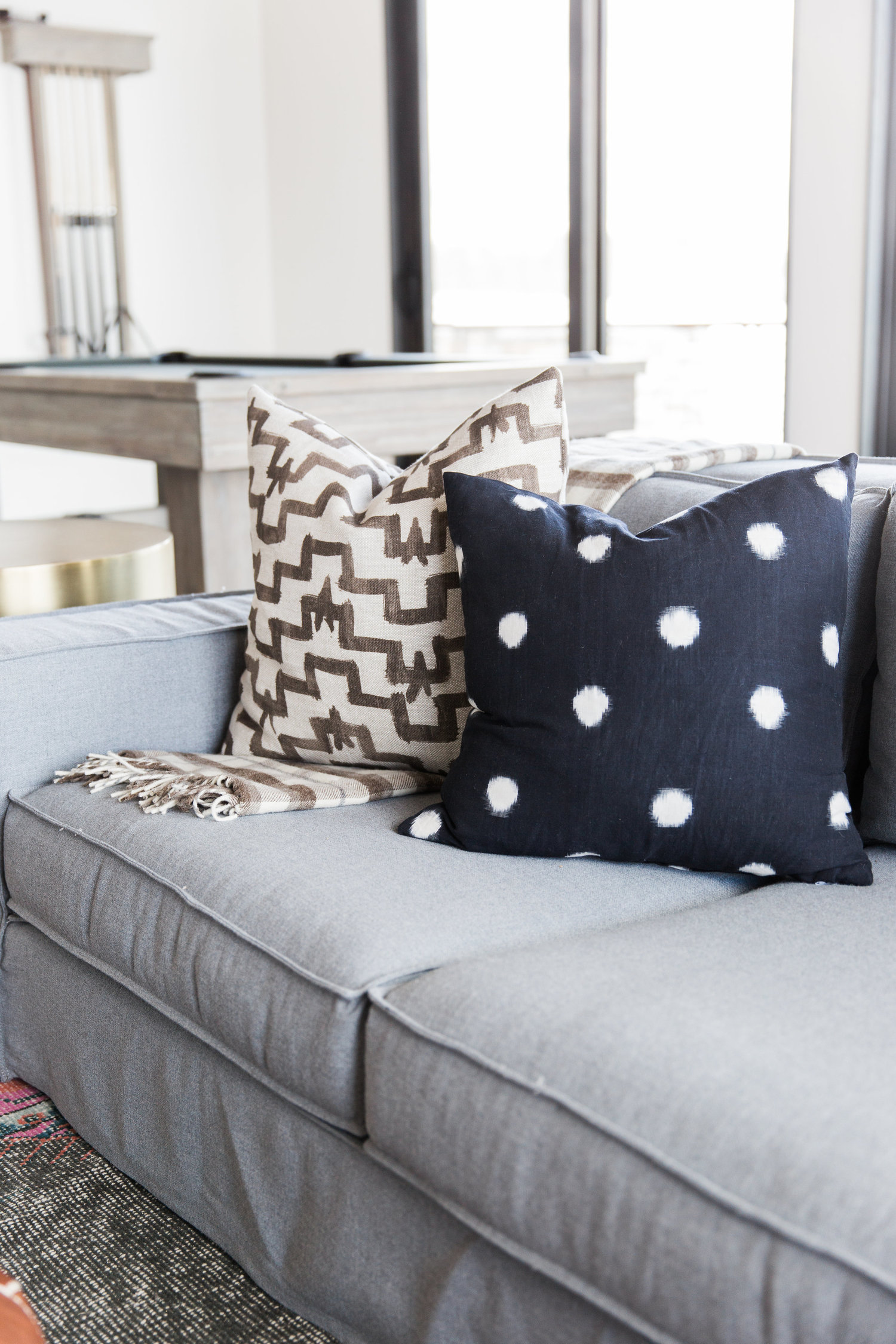 Decorative pillows on grey couch