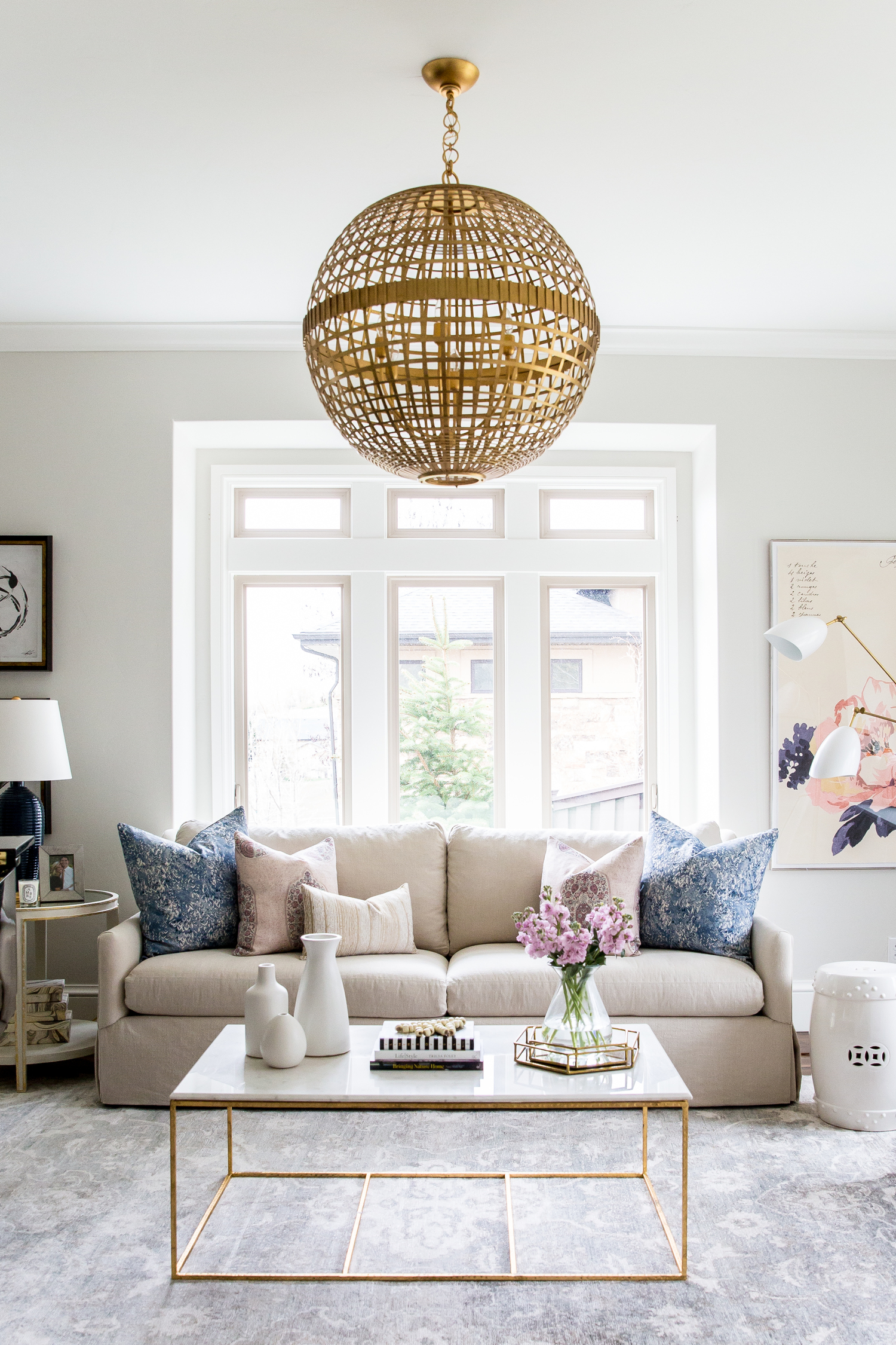 Tan statement sofa in front of large windows