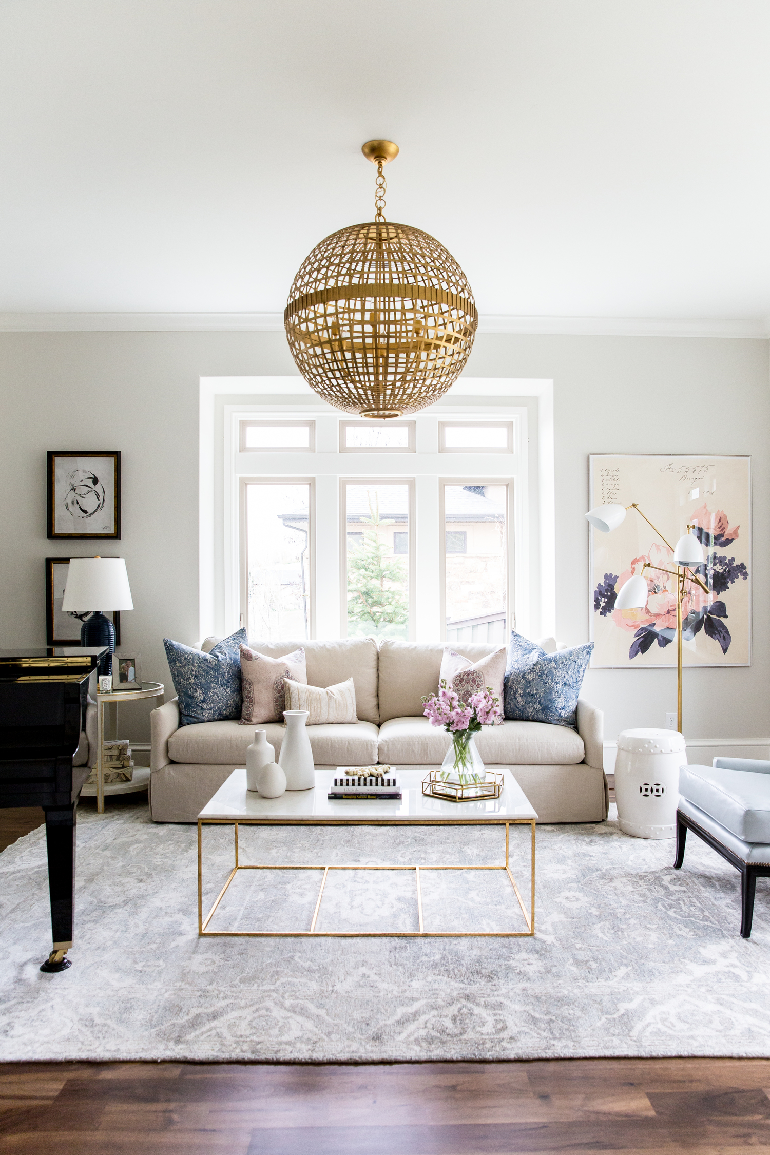 Tan sofa with glass coffee table in front