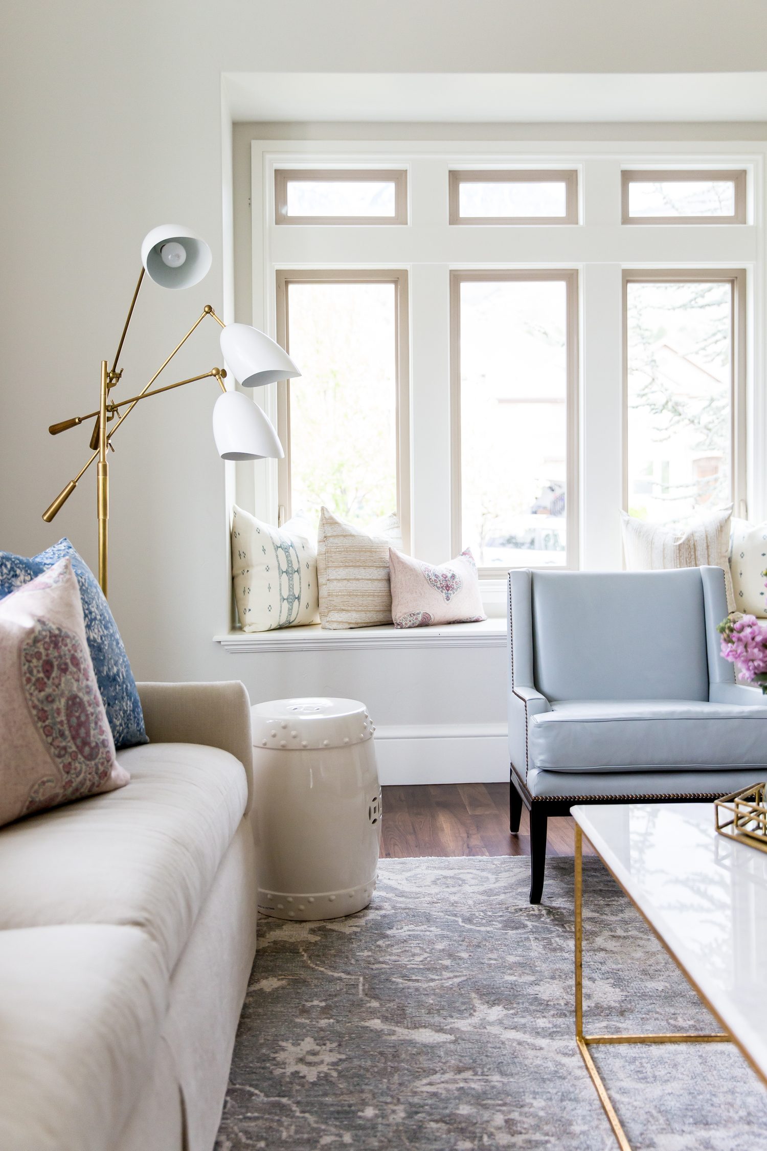 Blue chair in front of built in daybed