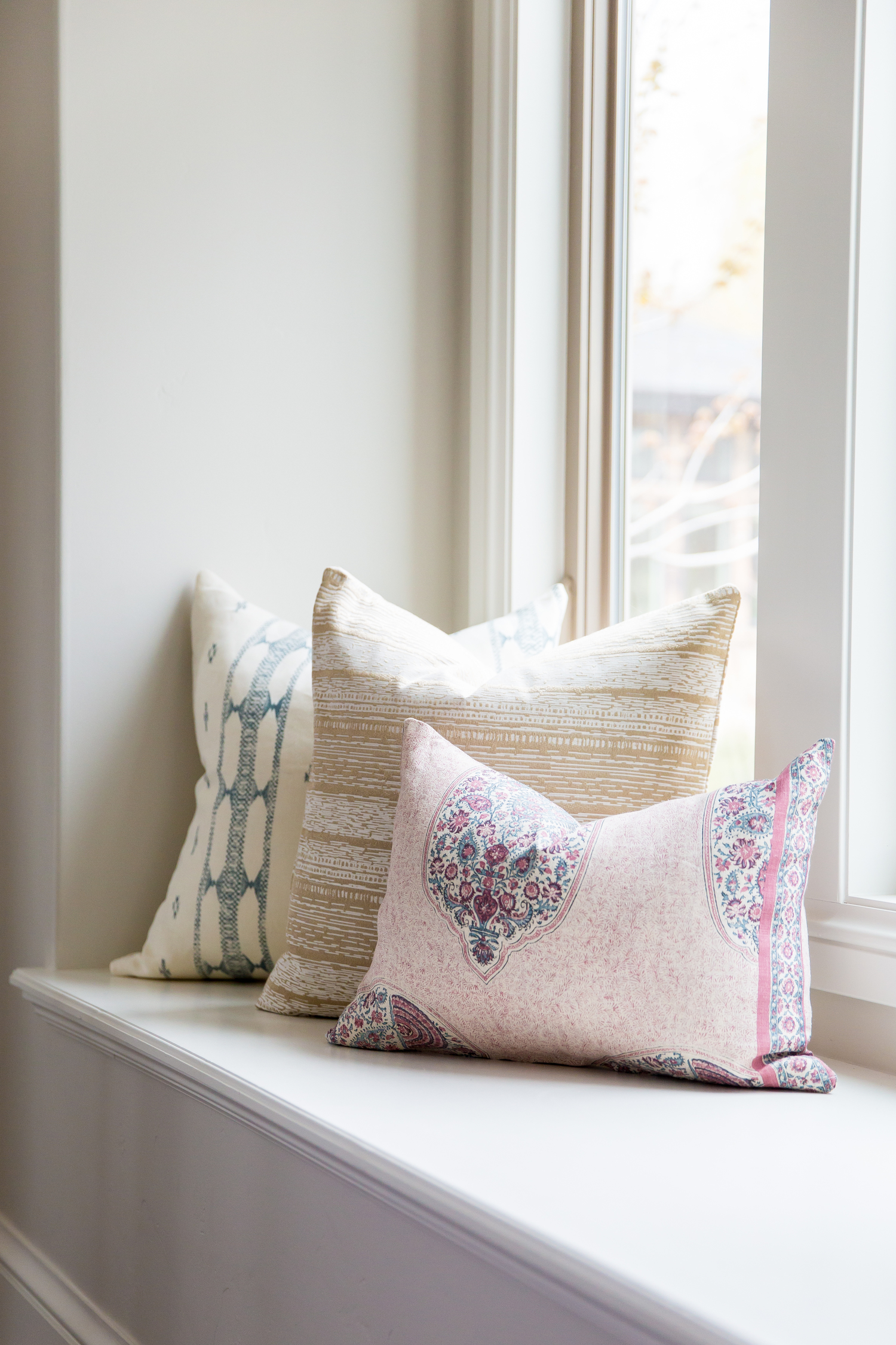 Decorative pillows in daybed of foothill home