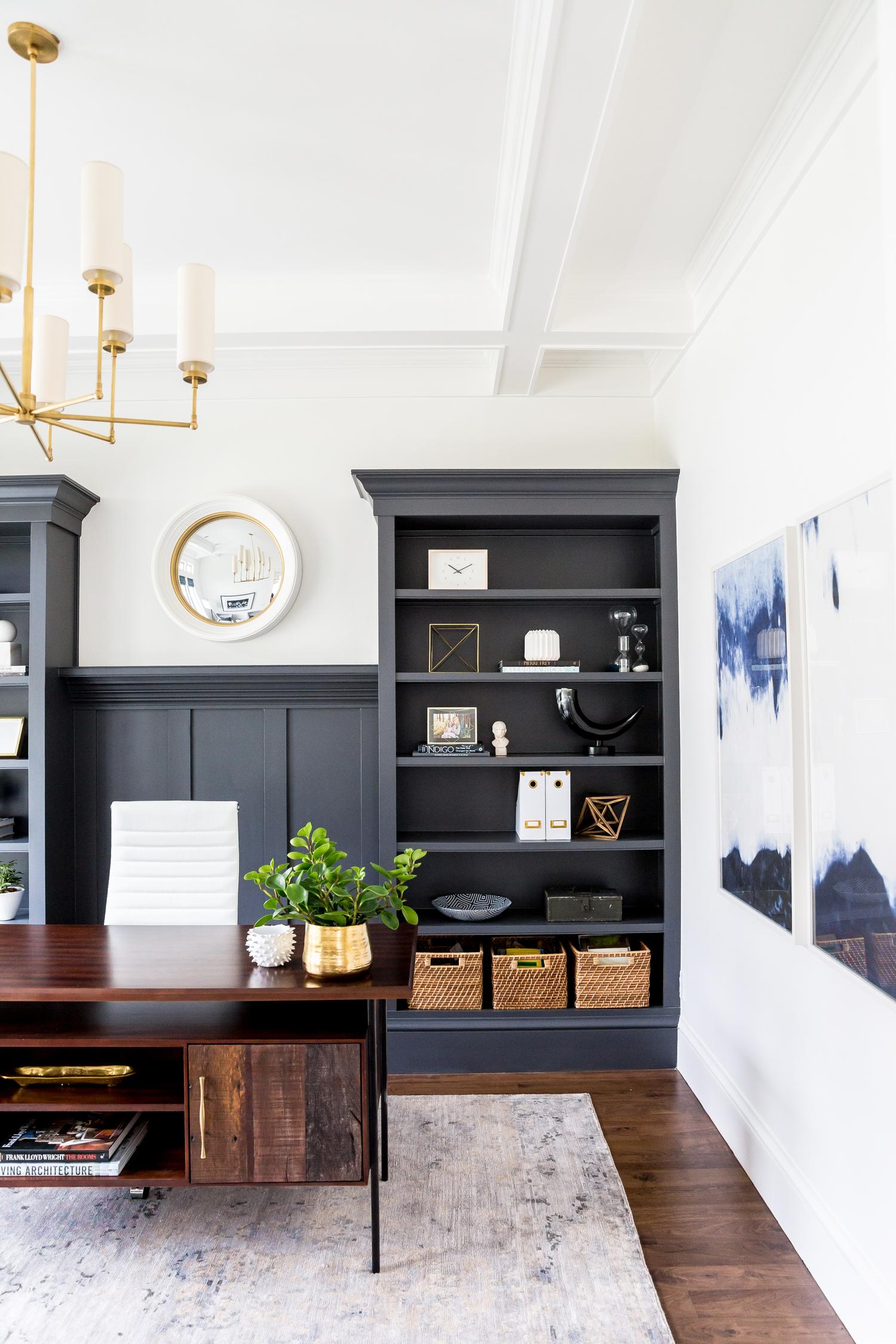 Dark grey build in shelves in room