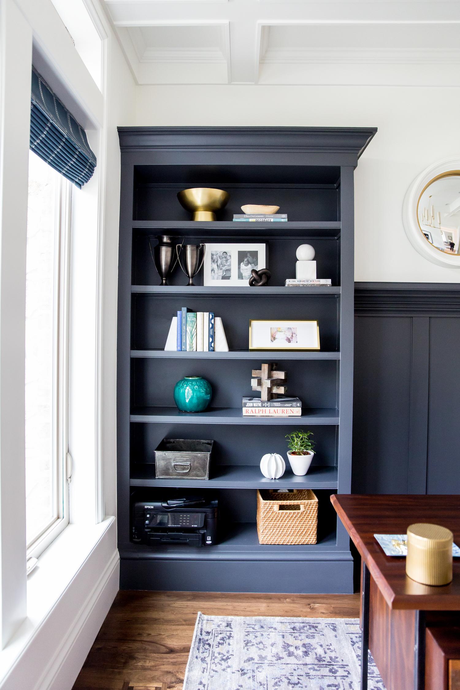 Decorative details atop built in shelves