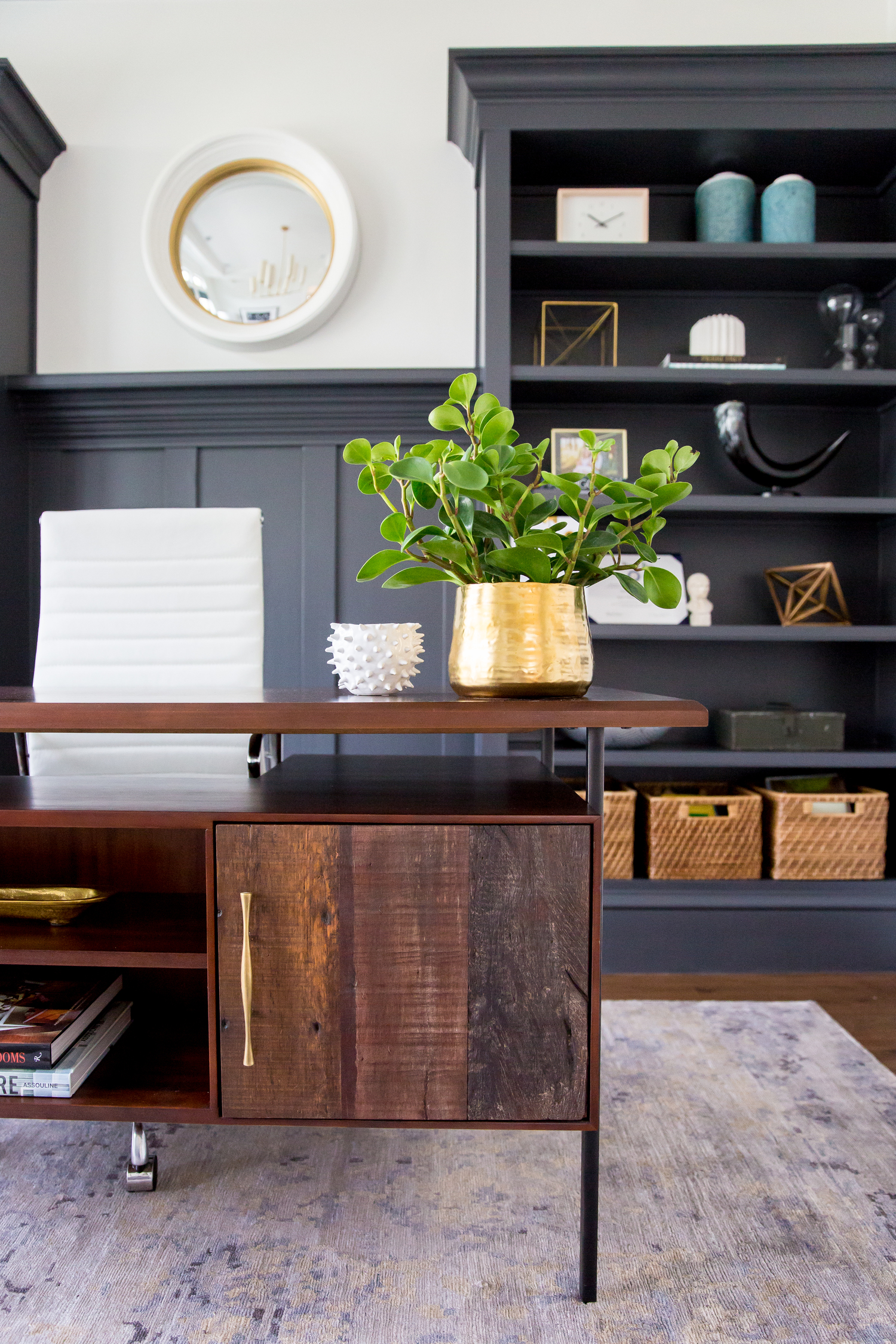 Rustic desk in front of built in shelves