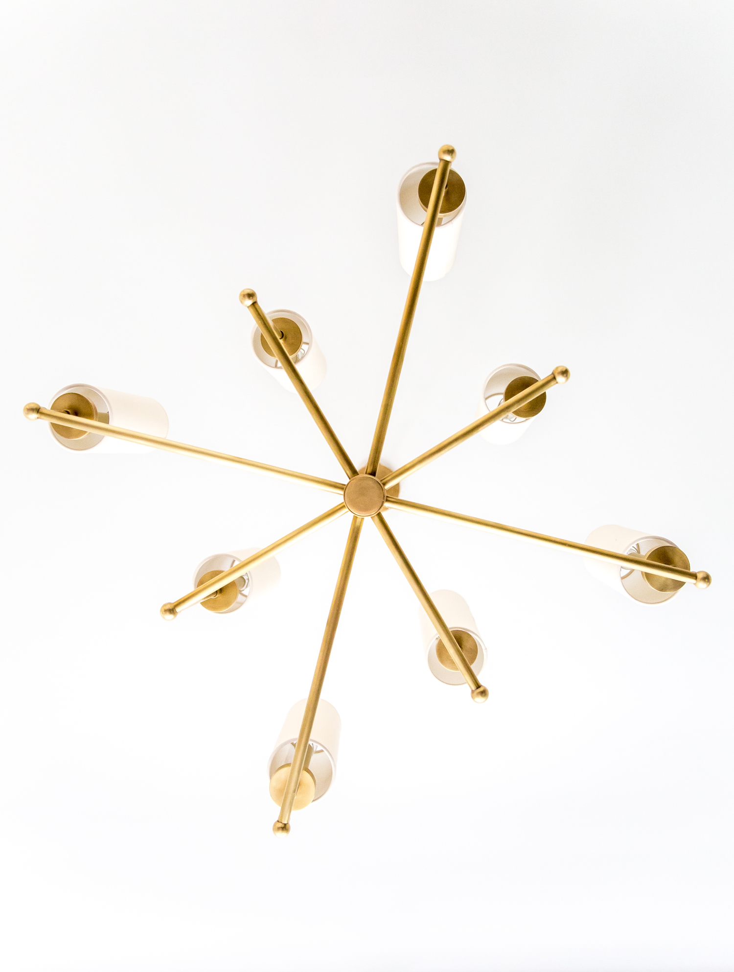 Modern, gold metal chandelier in office