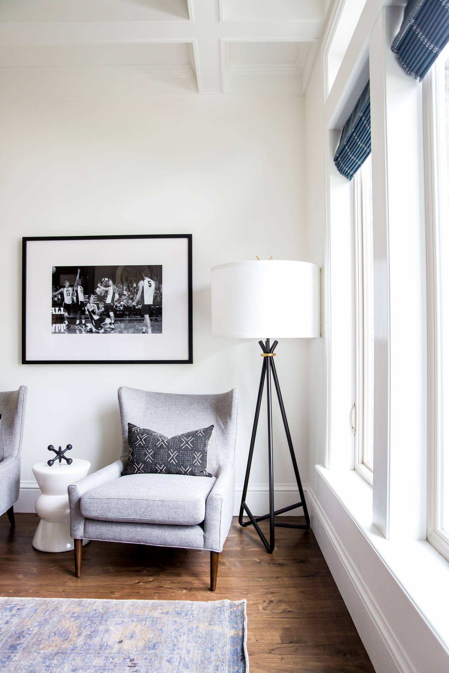 White and black lamp beside sofa seat