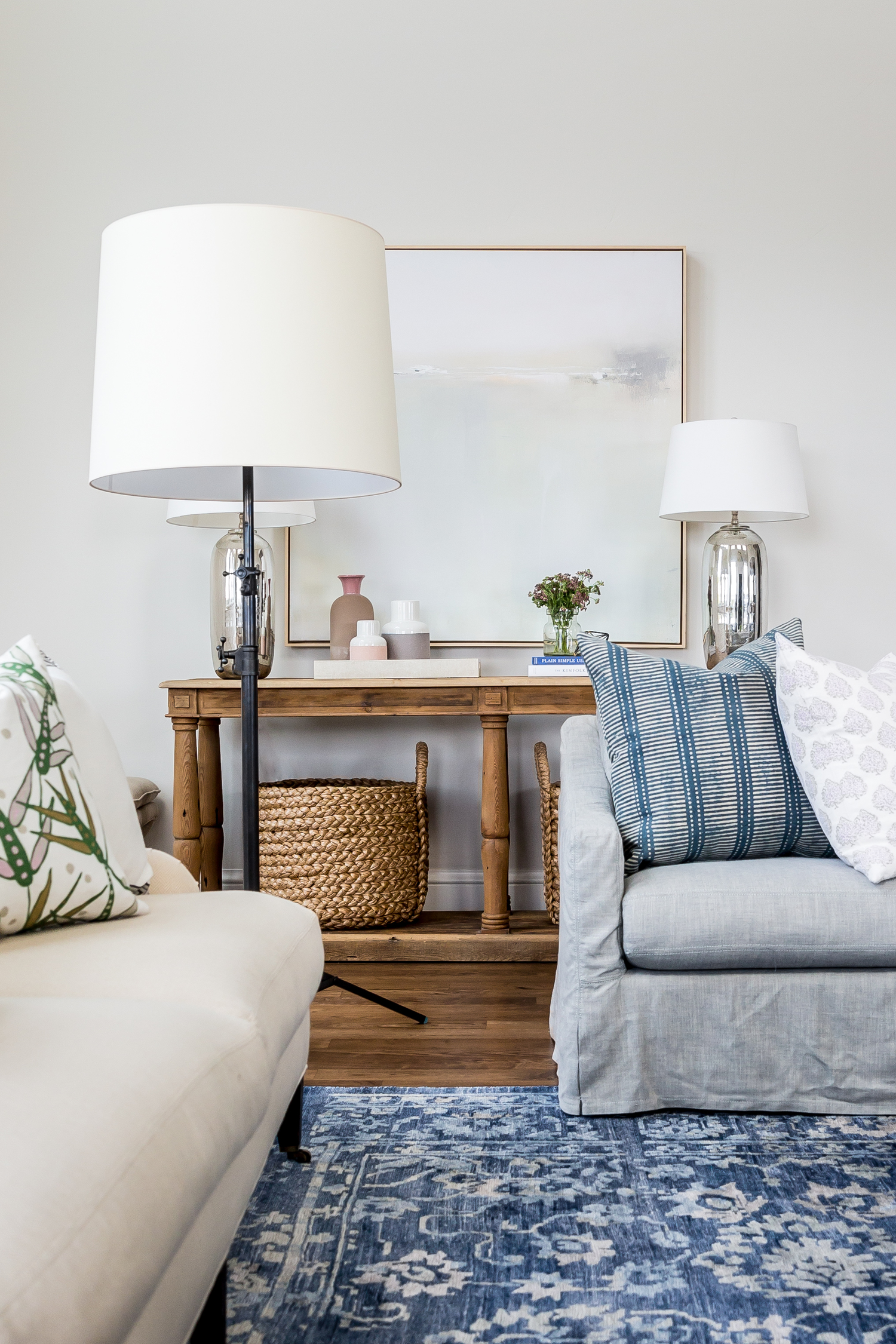 White and grey couches on blue and white area rug