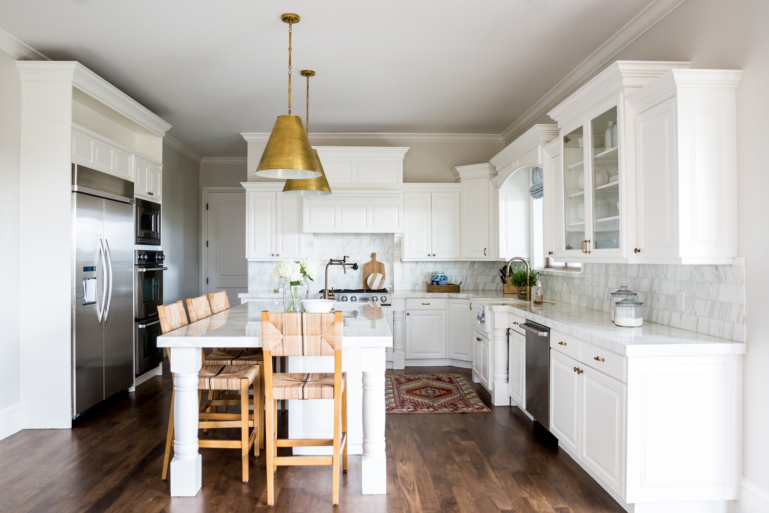 White kitchen with stainless steel accents