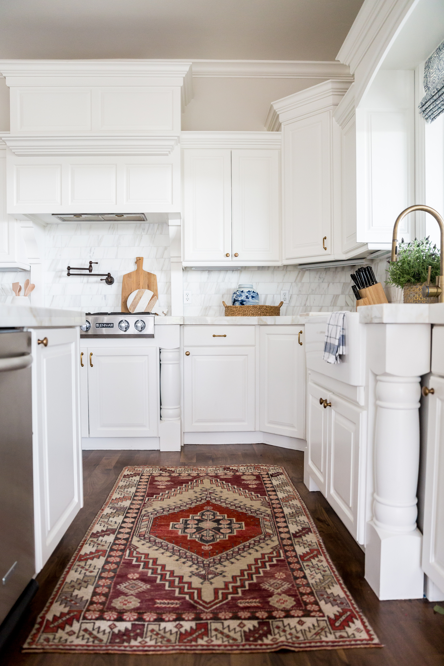 Red area rug in front of kitchen sink