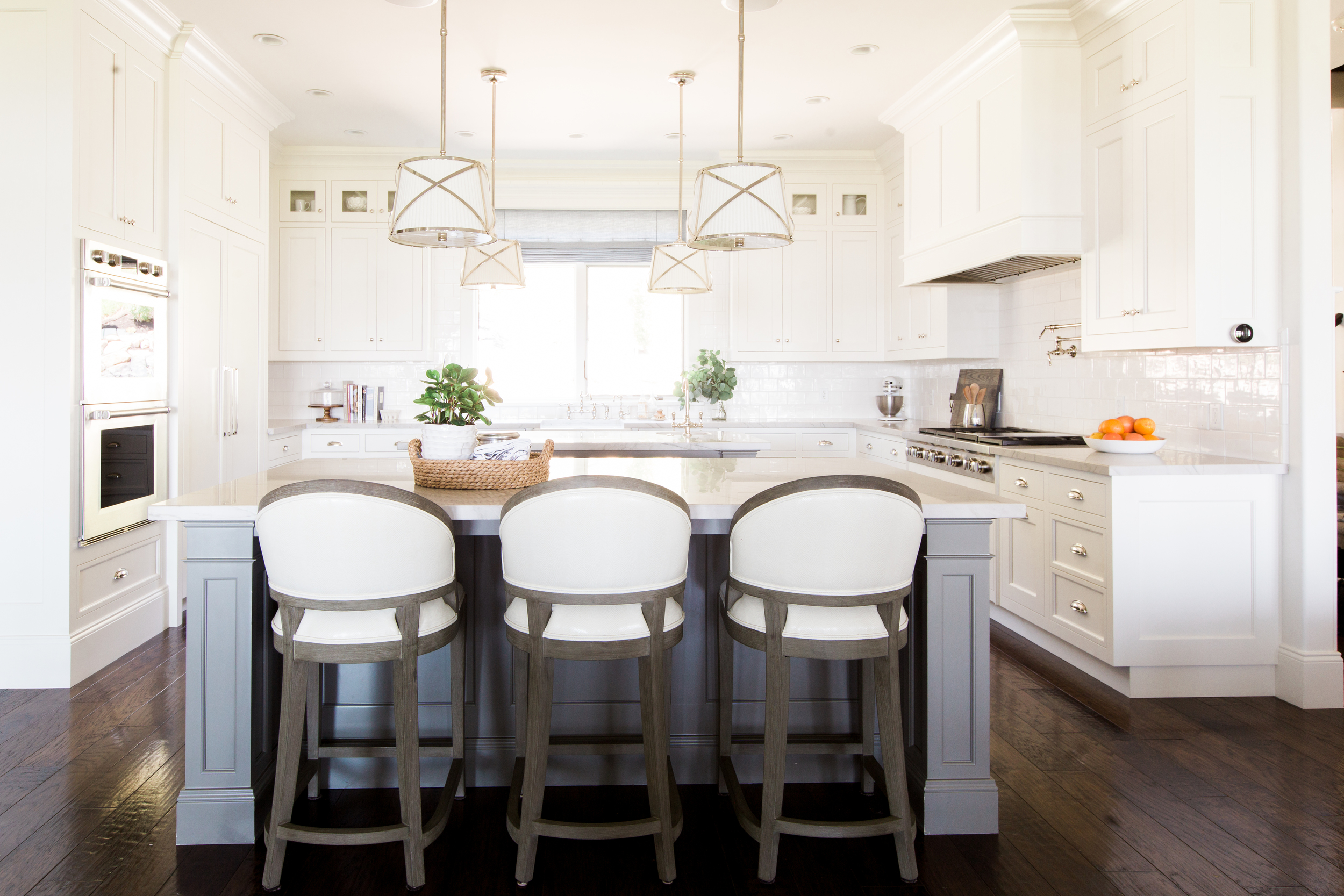 Creamy white cabinets and gray islands || Studio McGee