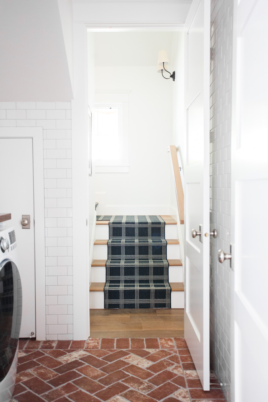 Brick herringbone floors and navy stair runner || Studio McGee