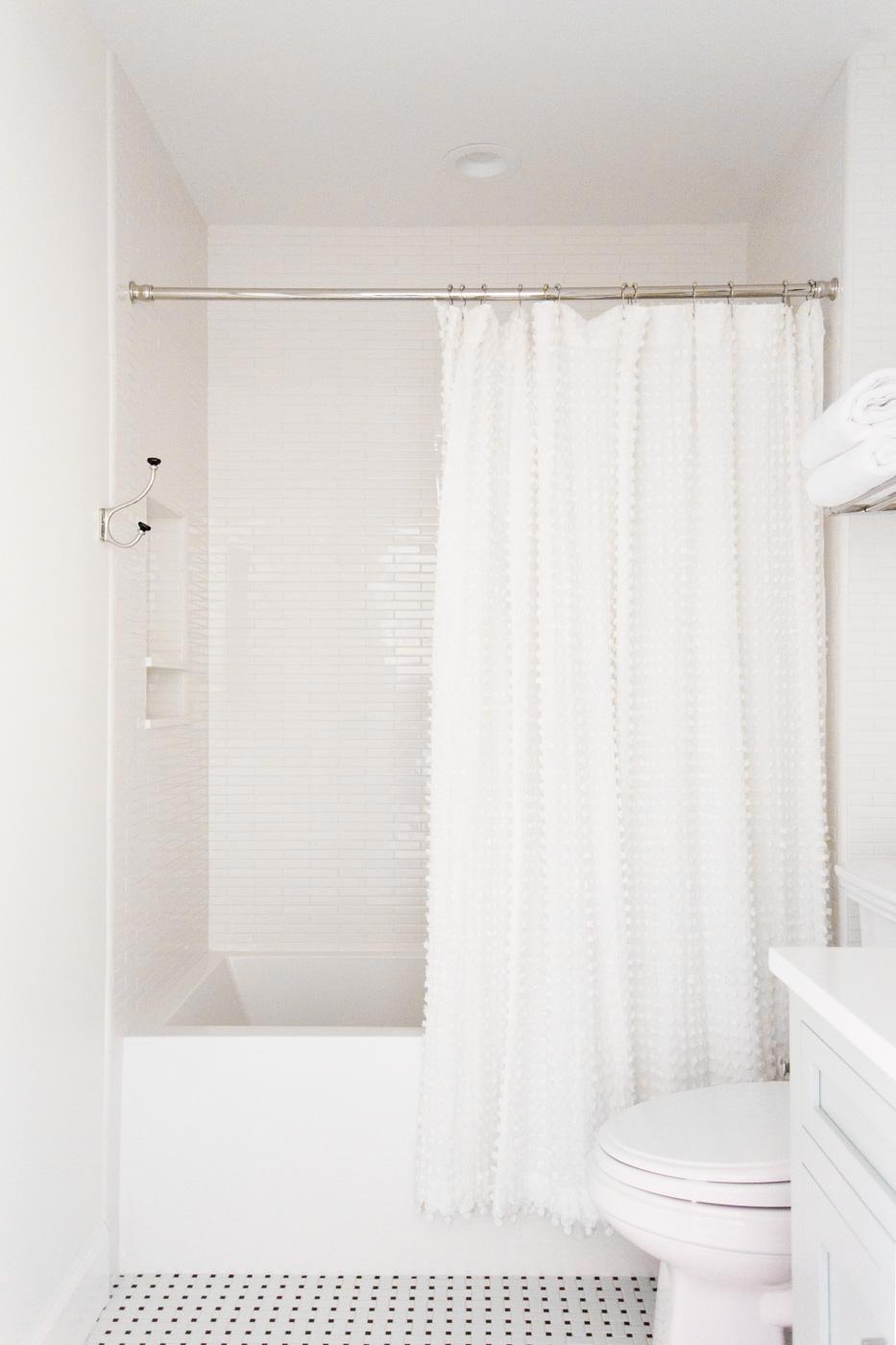 Black/white tile and pom pom shower curtain || Studio McGee
