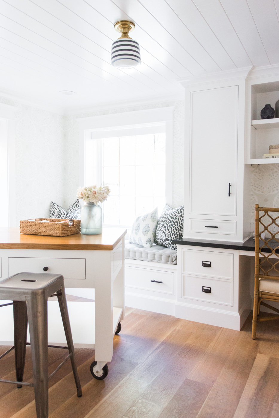 Window seat, built-in desk. and table on casters in the craft room || Studio McGee