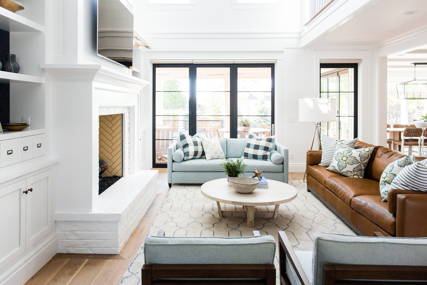Blue love seat next to brown sofa in living room