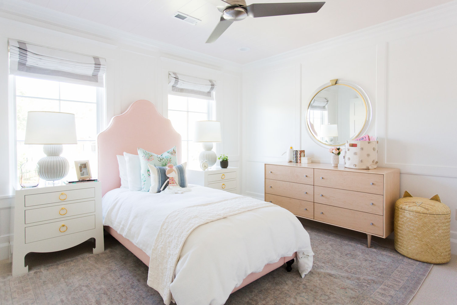 Pink and white bed in child's room
