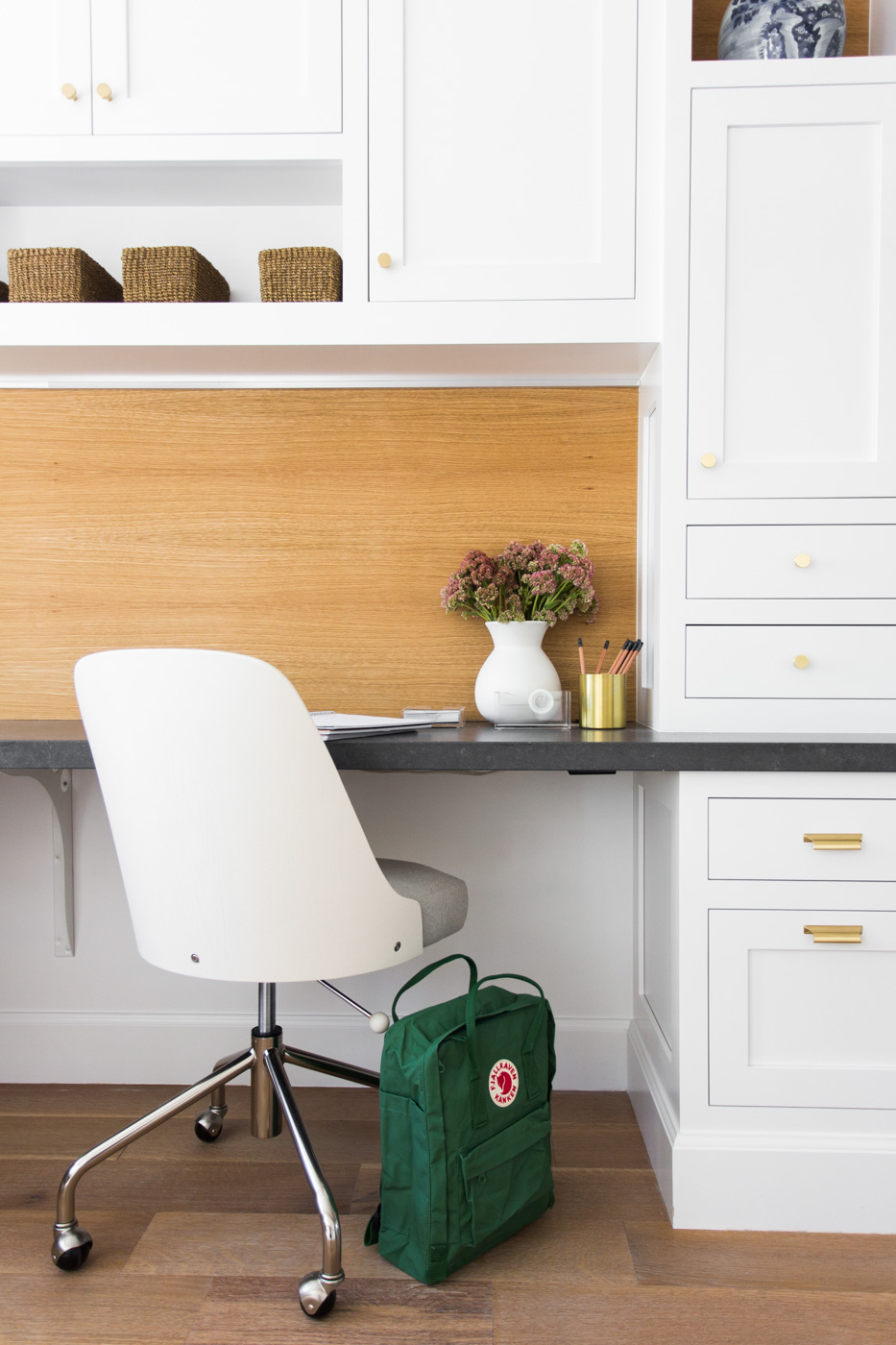 White rolling chair in front of built in desk