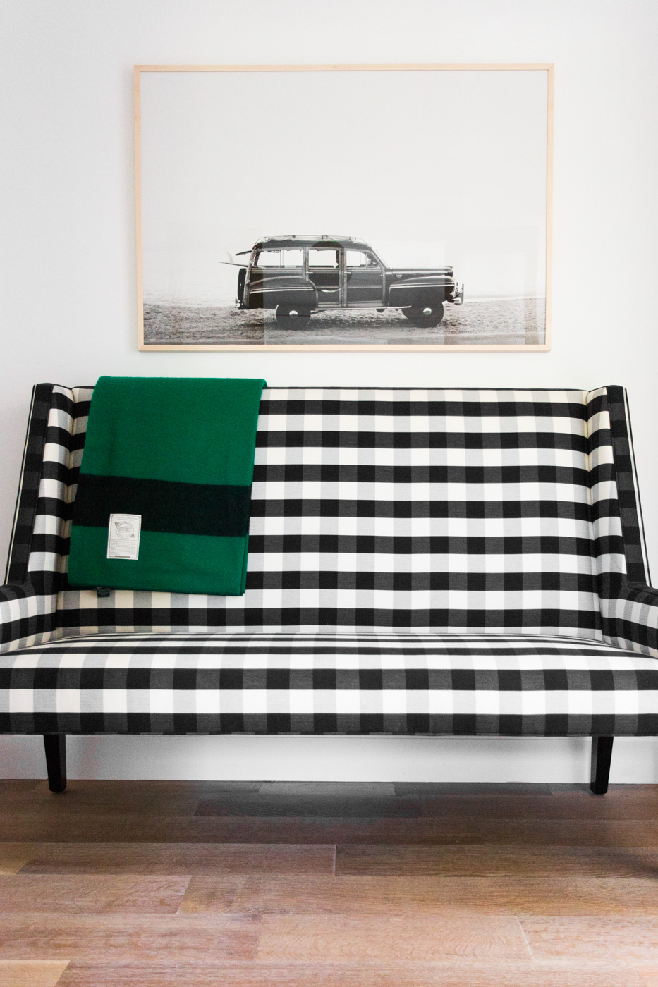Black and white love seat in hall