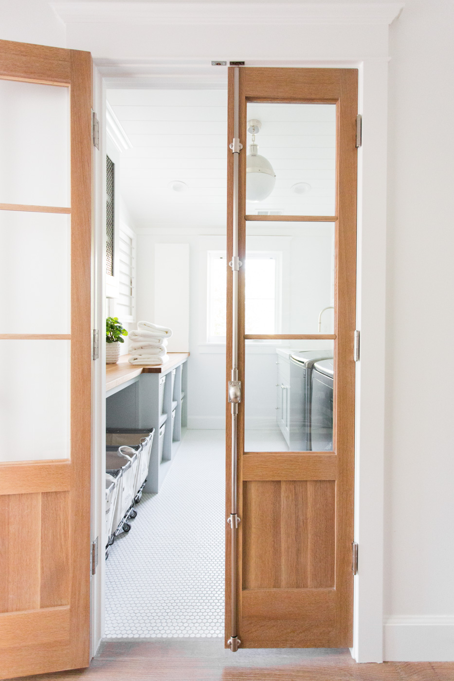Light wooden french doors to kitchen