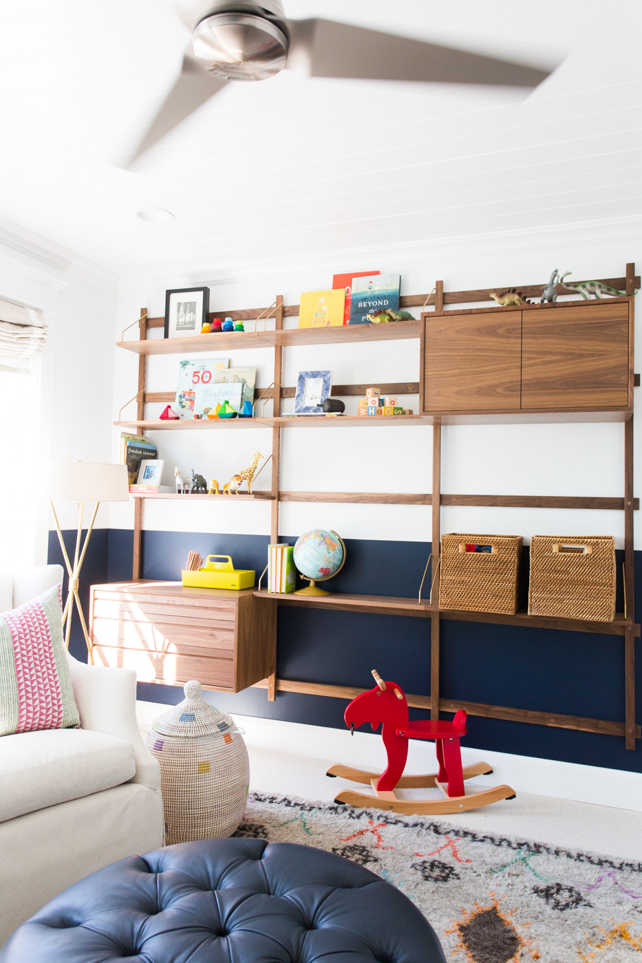 Built in shelves holding toys and games