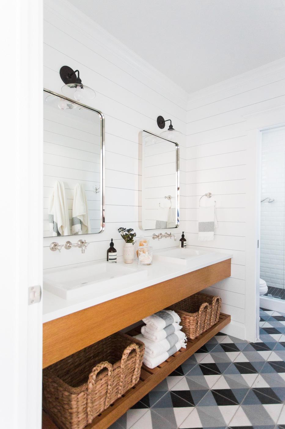 Tiled bathroom floor beneath vanity