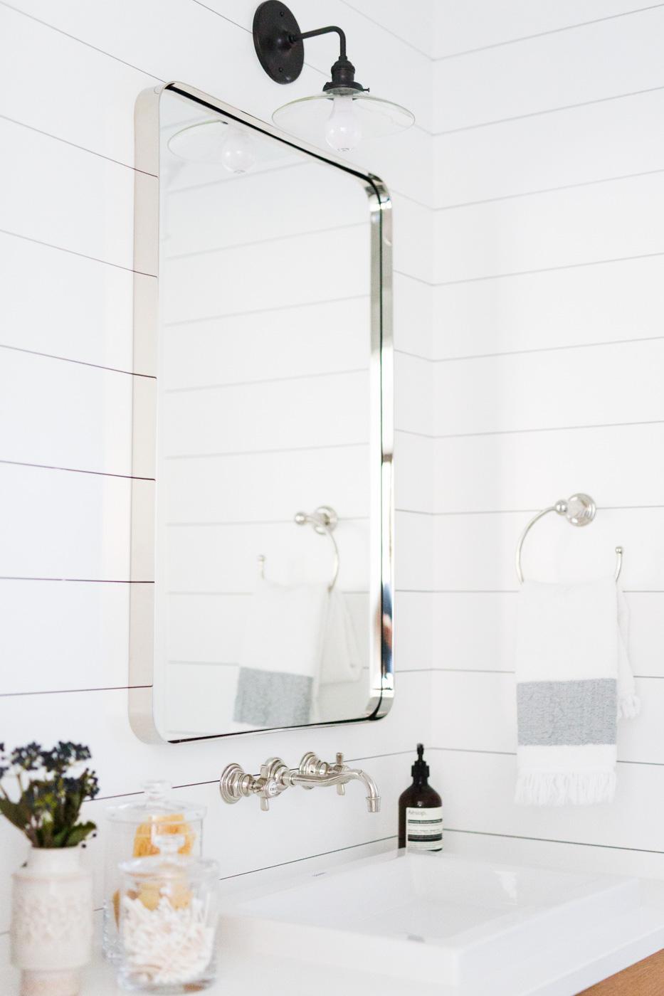 White mirror above bathroom sink